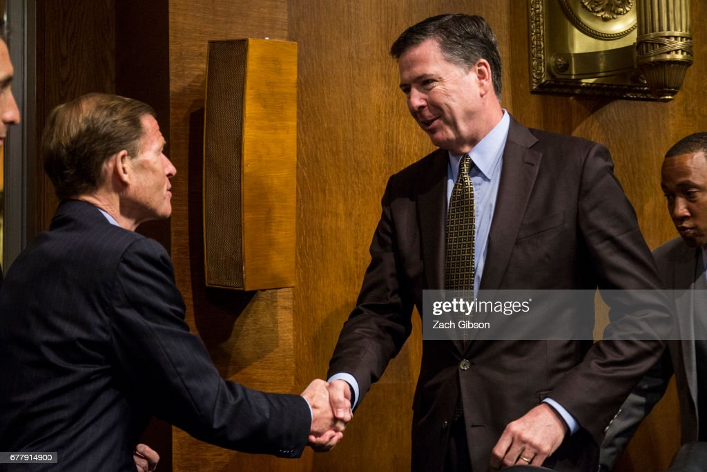 Director of the Federal Bureau of Investigation, James Comey shakes hands with Sen. Richard Blumenthal (D-CT) after testifying in front of the Senate Judiciary Committee during an oversight hearing on the FBI on Capitol Hill May 3, 2017 in Washington, DC. Comey is expected to answer questions about Russian involvement into the 2016 presidential election.