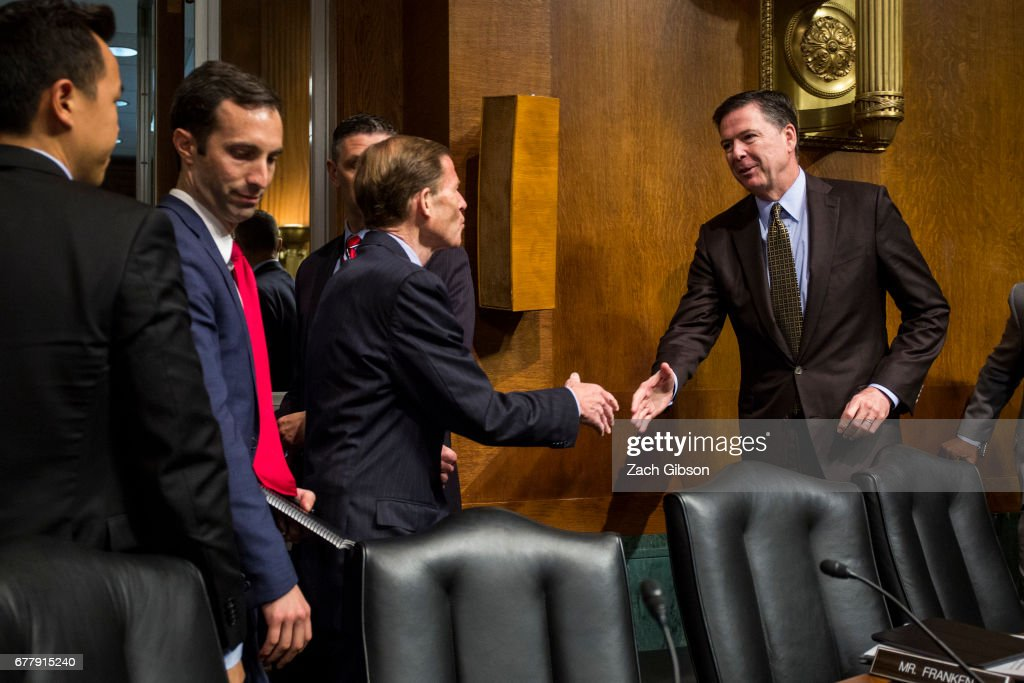 Director of the Federal Bureau of Investigation, James Comey (R) shakes hands with Sen. Richard Blumenthal (D-CT) after testifying in front of the Senate Judiciary Committee during an oversight hearing on the FBI on Capitol Hill May 3, 2017 in Washington, DC. Comey answered questions about Russian involvement into the 2016 presidential election.