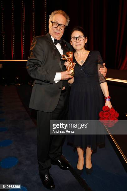 Director of the festival Dieter Kosslick and director Ildiko Enyedi pose with the Golden Bear for Best Film 'On Body and Soul' at the closing...