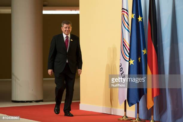 Director of the International Labour Organization Guy Ryder arrives to be welcomed from German Chancellor Angela Merkel prior to a first meeting of...