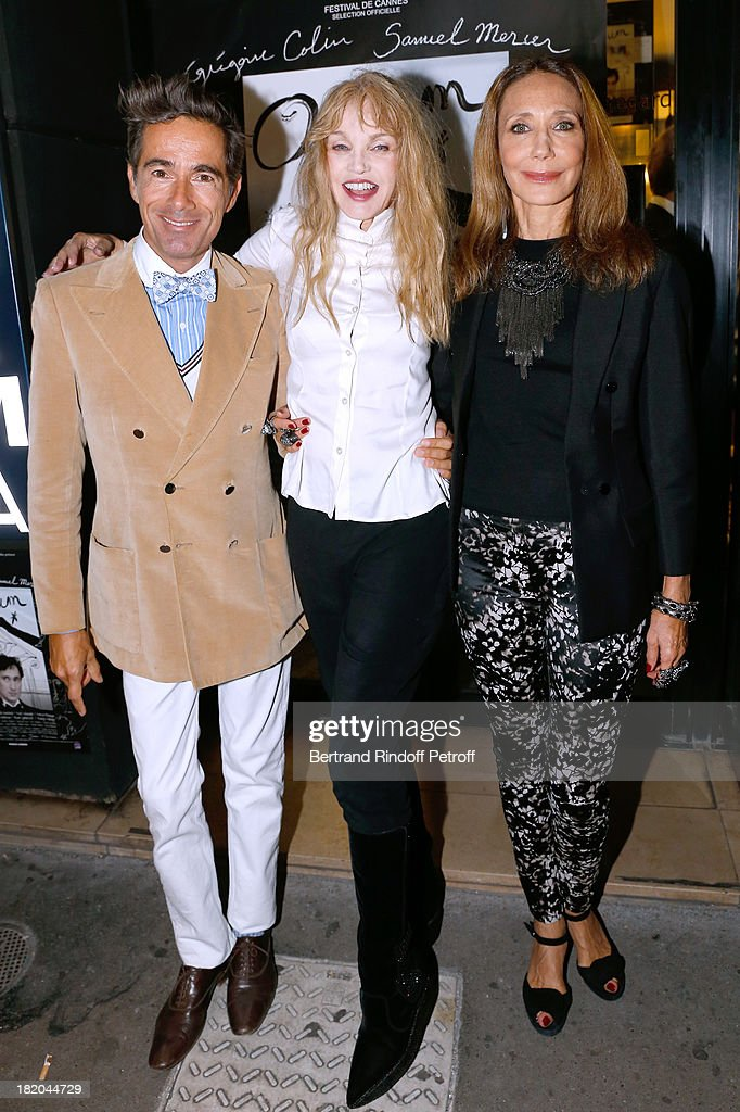 Director of the movie <a gi-track='captionPersonalityLinkClicked' href=/galleries/search?phrase=Arielle+Dombasle&family=editorial&specificpeople=616903 ng-click='$event.stopPropagation()'>Arielle Dombasle</a> between actors of the movie Vincent Darre and <a gi-track='captionPersonalityLinkClicked' href=/galleries/search?phrase=Marisa+Berenson&family=editorial&specificpeople=206844 ng-click='$event.stopPropagation()'>Marisa Berenson</a> attend 'Opium' movie Premiere, held at Cinema Saint Germain in Paris on September 27, 2013 in Paris, France.