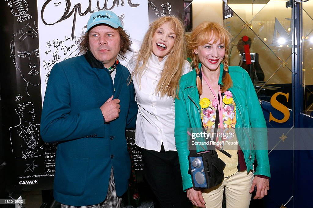 Director of the movie <a gi-track='captionPersonalityLinkClicked' href=/galleries/search?phrase=Arielle+Dombasle&family=editorial&specificpeople=616903 ng-click='$event.stopPropagation()'>Arielle Dombasle</a> between actors of the movie <a gi-track='captionPersonalityLinkClicked' href=/galleries/search?phrase=Julie+Depardieu&family=editorial&specificpeople=2247151 ng-click='$event.stopPropagation()'>Julie Depardieu</a> and companion Philippe Katerine attend 'Opium' movie Premiere, held at Cinema Saint Germain in Paris on September 27, 2013 in Paris, France.