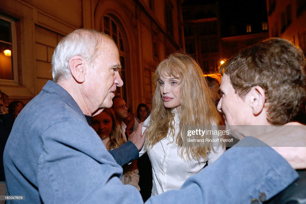 Director of the movie <a gi-track='captionPersonalityLinkClicked' href=/galleries/search?phrase=Arielle+Dombasle&family=editorial&specificpeople=616903 ng-click='$event.stopPropagation()'>Arielle Dombasle</a> between writer <a gi-track='captionPersonalityLinkClicked' href=/galleries/search?phrase=Milan+Kundera&family=editorial&specificpeople=724896 ng-click='$event.stopPropagation()'>Milan Kundera</a> and his wife attend the 'Opium' movie premiere, held at Cinema Saint Germain in Paris on September 27, 2013 in Paris, France.