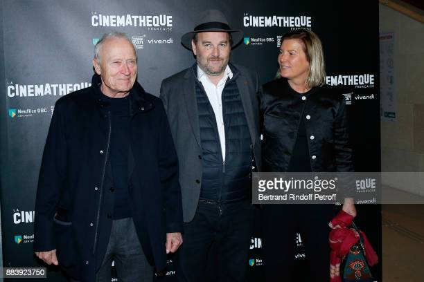 Director of the movie Xavier Beauvois standing between Producers of the movie President of Pathe Jerome Seydoux and his wife Sophie the 'Les...