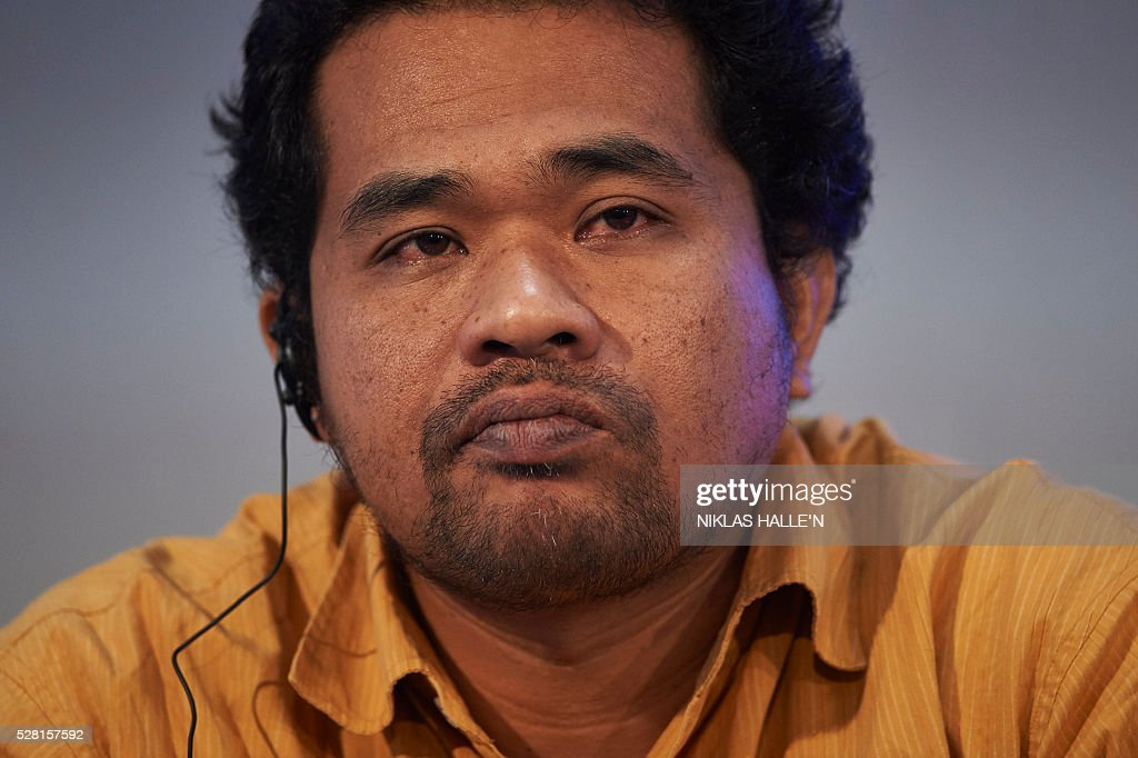 Forest Peoples Programme's representative from Indonesia, Agus Sutomo Suripto, listens during the Forest People Programme press conference at the Queen Elizabeth conference centre in central London on May 4, 2016. Indigenous and civil society leaders from Indonesia, Peru, Colombia and Liberia gathered in London Wednesday to urge a boycott of firms that commit human rights violations and land seizures to cultivate palm oil. The EU is the third largest importer of palm oil, a key ingredient in many everyday goods, from biscuits to make-up. / AFP / NIKLAS HALLE'N