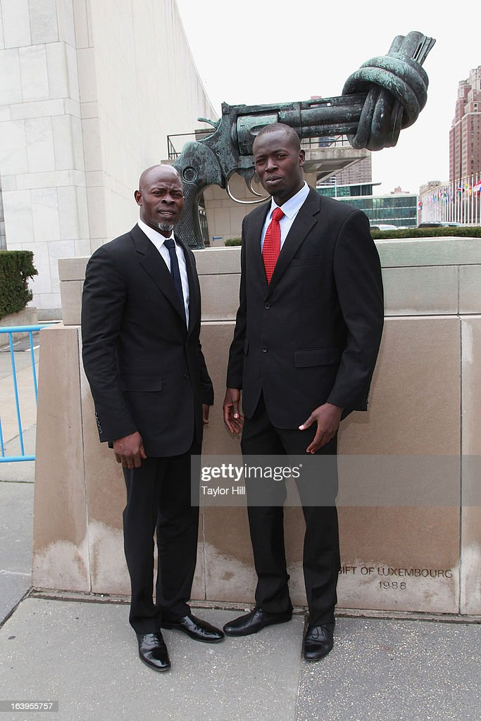 Director of the South Sudan Action Network in Small Arms Geoffrey Duke and actor <a gi-track='captionPersonalityLinkClicked' href=/galleries/search?phrase=Djimon+Hounsou&family=editorial&specificpeople=204469 ng-click='$event.stopPropagation()'>Djimon Hounsou</a> (L) attend Oxfam International's Arms Control Campaign Launch at the Knotted Gun sculpture at the United Nations on March 18, 2013 in New York City.