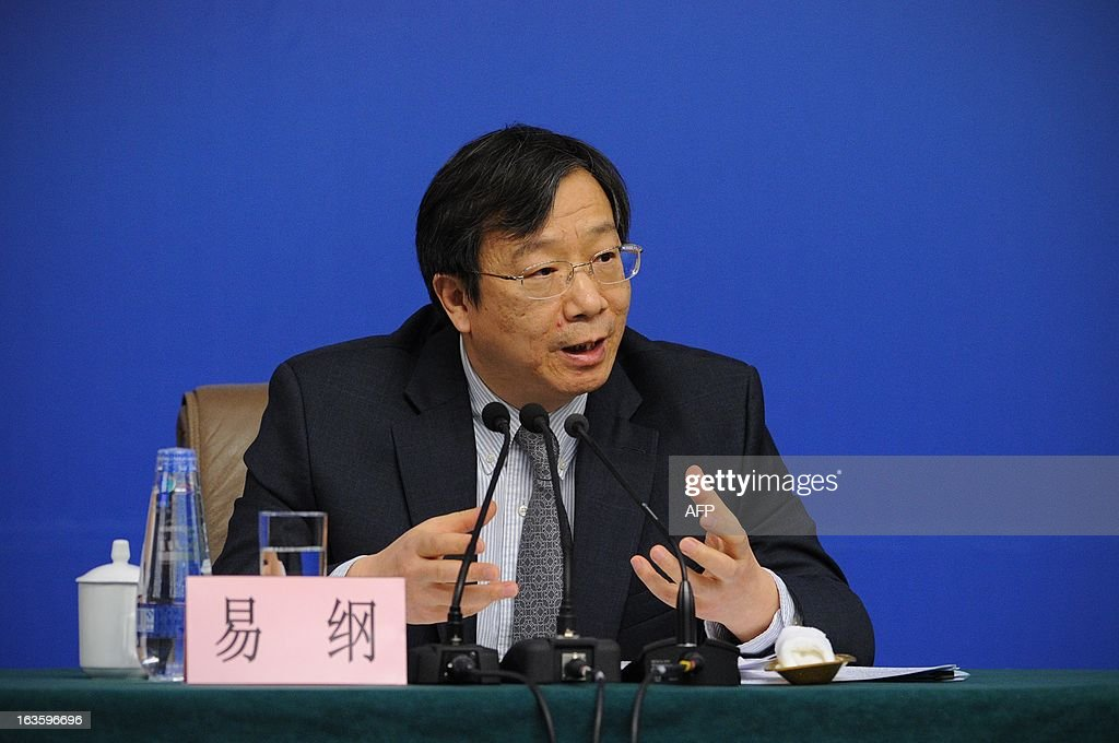 Director of the State Administration of Foreign Exchange, Yi Gang answers questions during a press conference in the first session of the 12th National People's Congress (NPC) in Beijing on March 13, 2013. Thousands of delegates from across China meet this week to seal a power transfer to new leaders whose first months running the Communist Party have pumped up expectations with a deluge of propaganda.