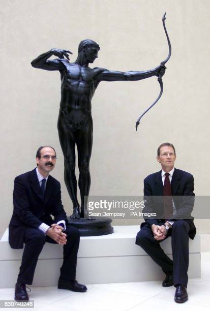 Director of the Tate Britain Stephen Deuchar and Director of Tate Nicholas Serota sit beneath a bronze by Hamo Thornycroft 1881 as part of the Tate...