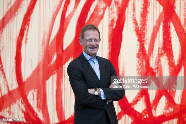 Director of the Tate Sir Nicholas Serota in front of 'Untitled 20062008 Acrylic on canvas' by Cy Twombly at Tate Modern in central London after it...