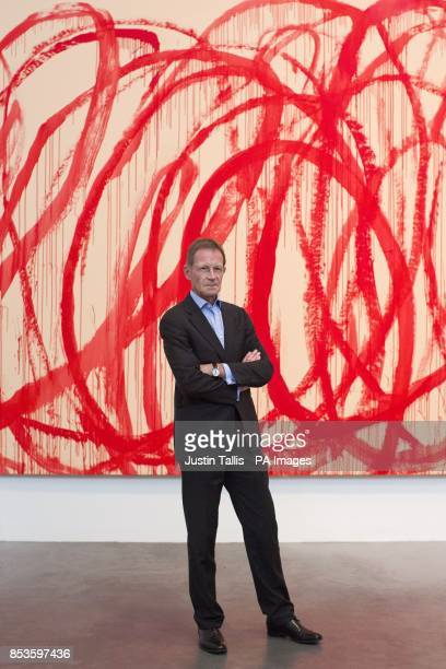 Director of the Tate Sir Nicholas Serota in front of Untitled 20062008 Acrylic on canvas by Cy Twombly at Tate Modern in central London after it was...