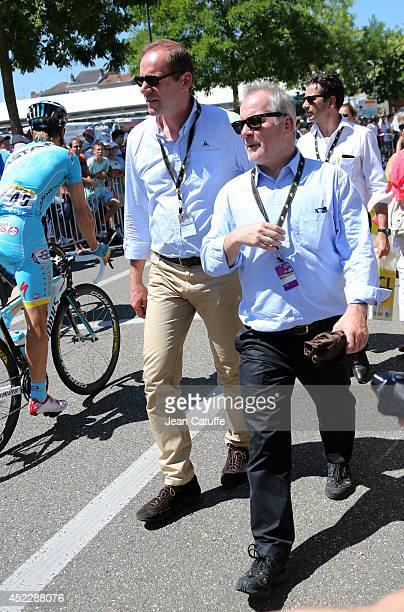 Director of the Tour de France Christian Prudhomme and director of the Cannes Film Festival Thierry Fremaux attend stage twelve of the 2014 Tour de...