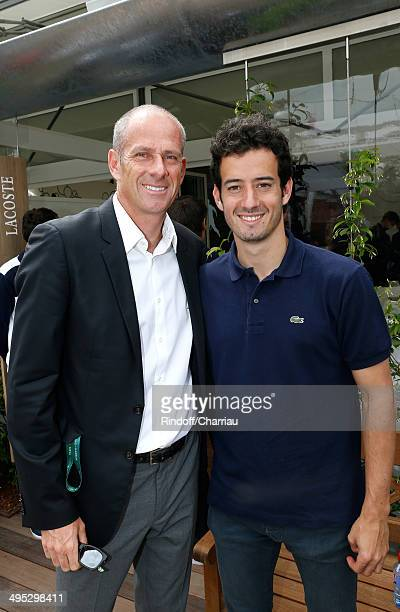 Director of the tournament Guy Forget and his son actor Thomas Forget attend the Roland Garros French Tennis Open 2014 Day 9 on June 2 2014 in Paris...
