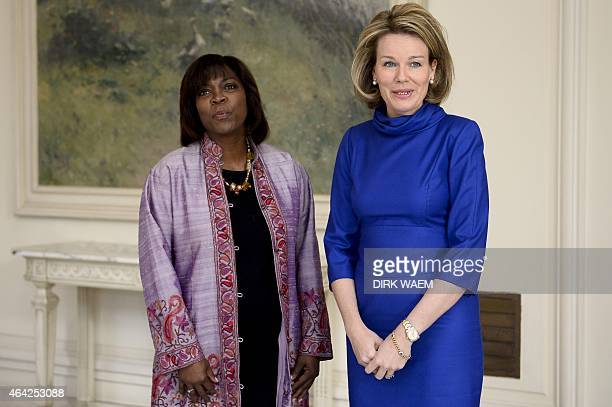 Director of the United Nations World Food Programme Ertharin Cousin and Belgian Queen Mathilde pose during a meeting at the Royal palace in Brussels...