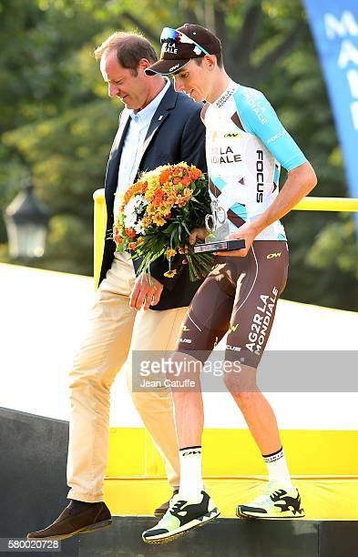 Director of Tour de France Christian Prudhomme and Romain Bardet of France and AG2R La Mondiale and winner Chris Froome of Great Britain and Team Sky...