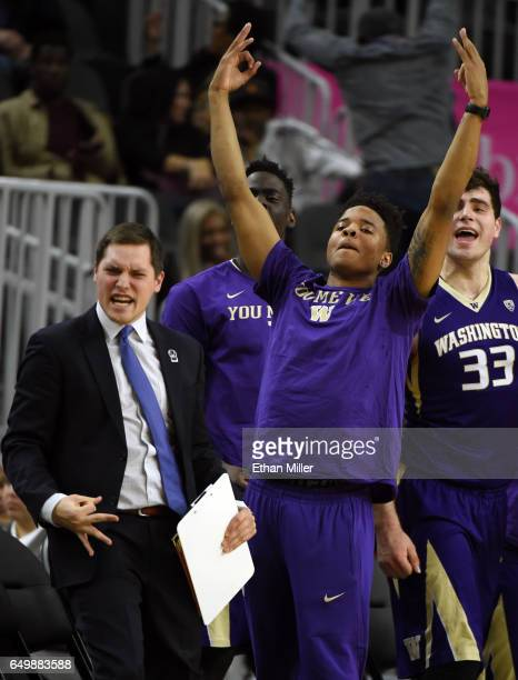 Director of video operations Jake Wisness of the Washington Huskies and Markelle Fultz of the Huskies react on the bench after a Washington 3pointer...