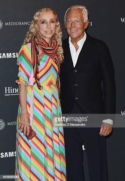 Director of Vogue Italia Franca Sozzani and Giorgio Armani attend Vogue Italia 50th Anniversary Event on September 21 2014 in Milan Italy