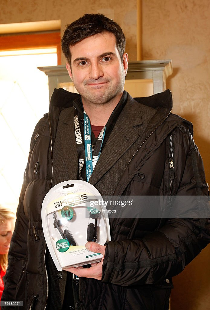Director Oliver Blackburn poses with the Koss display at the Gibson Guitar celebrity hospitality lounge held at the Miners Club during the 2008 Sundance Film Festival on January 23, 2008 in Park City, Utah.