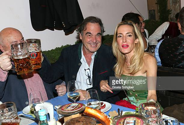Director Oliver Stone and his nice Caroline Goddet during the Oktoberfest at Kaeferschaenke at Theresienwiese on September 20 2016 in Munich Germany