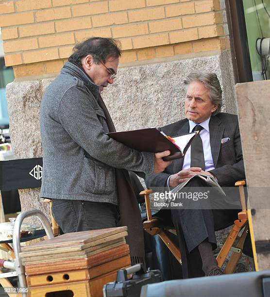Director Oliver Stone and Michael Douglas on location for 'Wall Street 2' on the streets of Manhattan on November 16 2009 in New York City