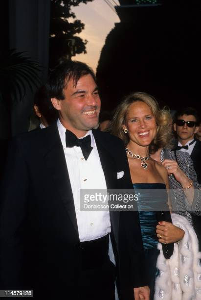 Director Oliver Stone and wife Elizabeth Stone at Academy Awards in March 1987 in Los Angeles California
