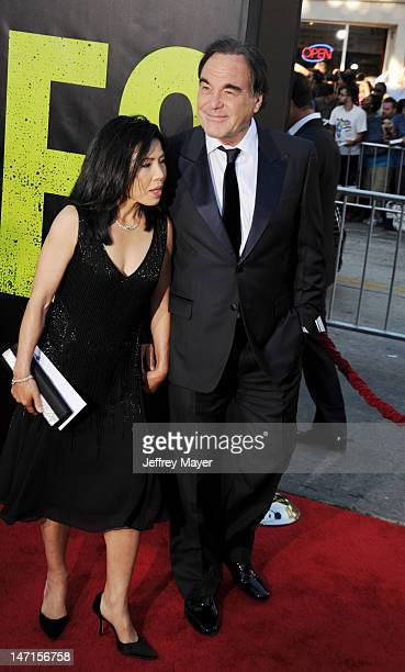 Director Oliver Stone and wife Sunjung Jung arrive at the Los Angeles premiere of 'Savages' at Mann Village Theatre on June 25 2012 in Westwood...