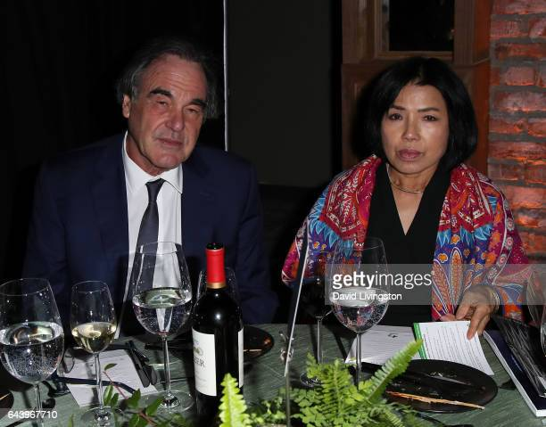 Director Oliver Stone and wife Sunjung Jung attend the 14th Annual Global Green PreOscar Gala at TAO Hollywood on February 22 2017 in Los Angeles...