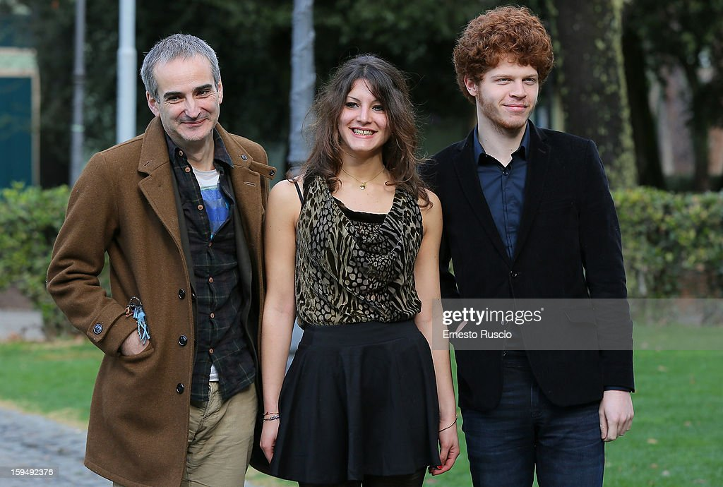 Director Olivier Assayas, actress Carole Combes and actor Hugo Conzelmann attend the 'Apres Mai' photocall at Casa del Cinema on January 14, 2013 in Rome, Italy.