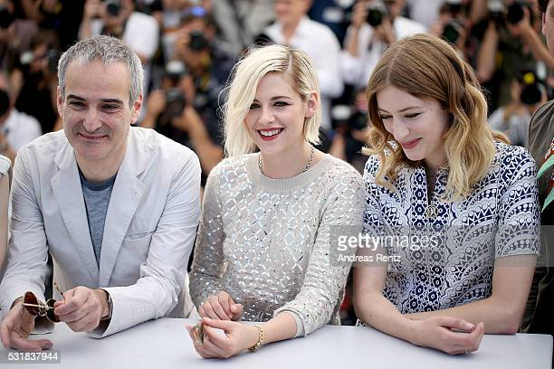Director Olivier Assayas actresses Kristen Stewart and Sigrid Bouaziz attend the 'Personal Shopper' photocall during the 69th annual Cannes Film...