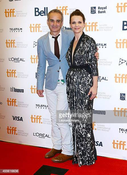 Director Olivier Assayas and actress Juliette Binoche arrives at the 'Clouds Of Sils Maria' Premiere during Toronto International Film Festival at...