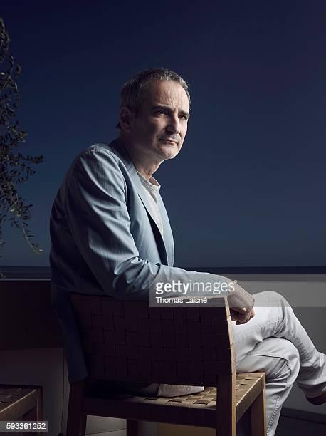 Director Olivier Assayas is photographed for Self Assignment on May 17 2014 in Cannes France