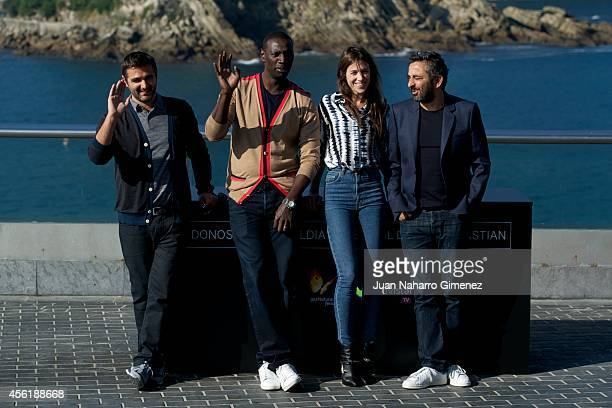 Director Olivier Nakache actor Omar Sy actress Charlotte Gainsbourg and director Eric Toledano attend the 'Samba' photocall at the Aquarium during...