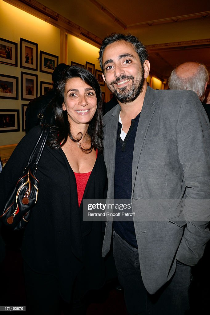 Director Olivier Nakache with his wife attend the Ary Abittan performance at Theater Edouard VII benefiting 'Un Coeur Pour La Paix' on June 24, 2013 in Paris, France.