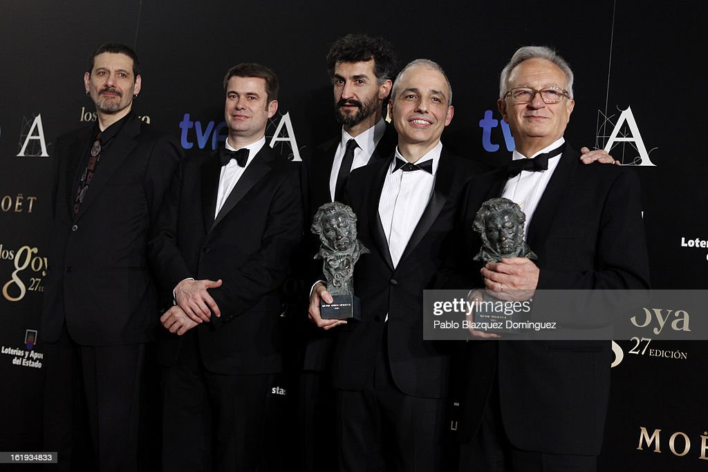 Director Pablo Berger (2R) holds the award for Best Original Screenplay in the film 'Blancanieves' during the 2013 edition of the 'Goya Cinema Awards' ceremony at Centro de Congresos Principe Felipe on February 17, 2013 in Madrid, Spain.