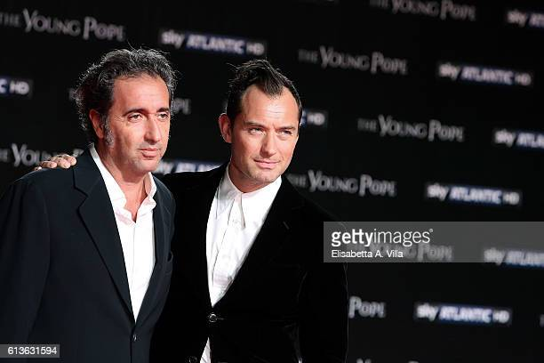 Director Paolo Sorrentino and actor Jude Law walk the red carpet at 'The Young Pope' premiere on October 9 2016 in Rome Italy
