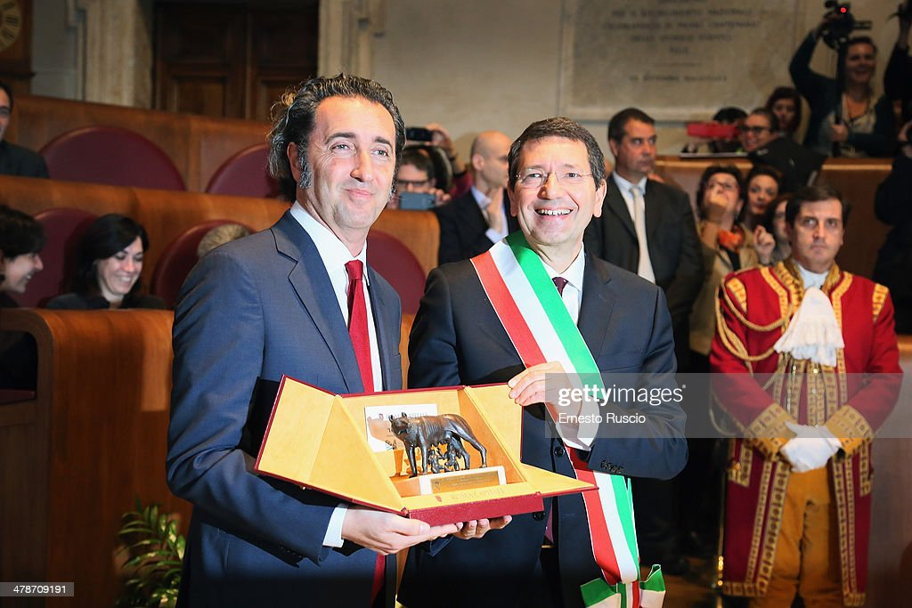 Director Paolo Sorrentino and major Ignazio Marino attend the Honorary Citizenship Of Rome at Campidoglio on March 14 2014 in Rome Italy