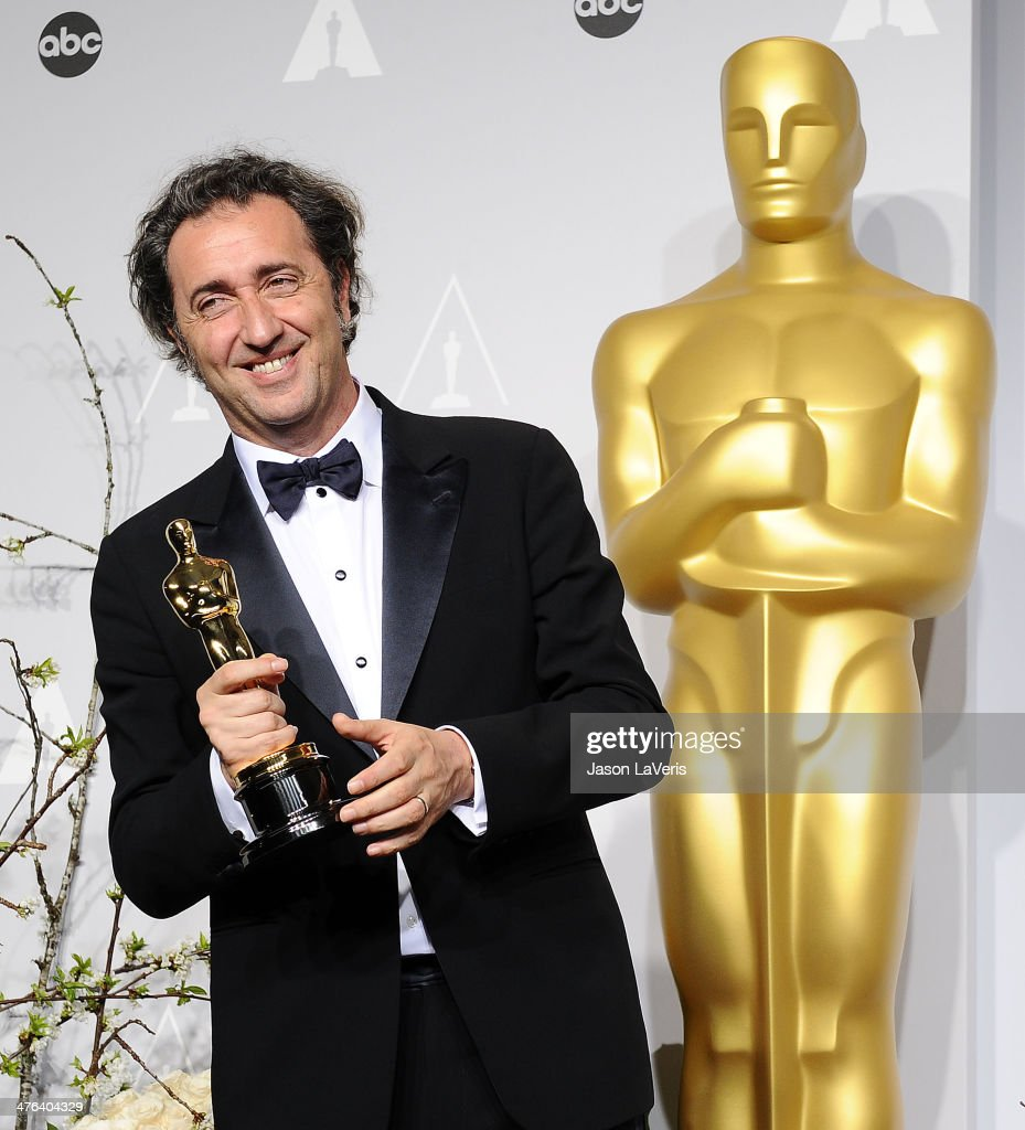 Director Paolo Sorrentino poses in the press room at the 86th annual Academy Awards at Dolby Theatre on March 2 2014 in Hollywood California