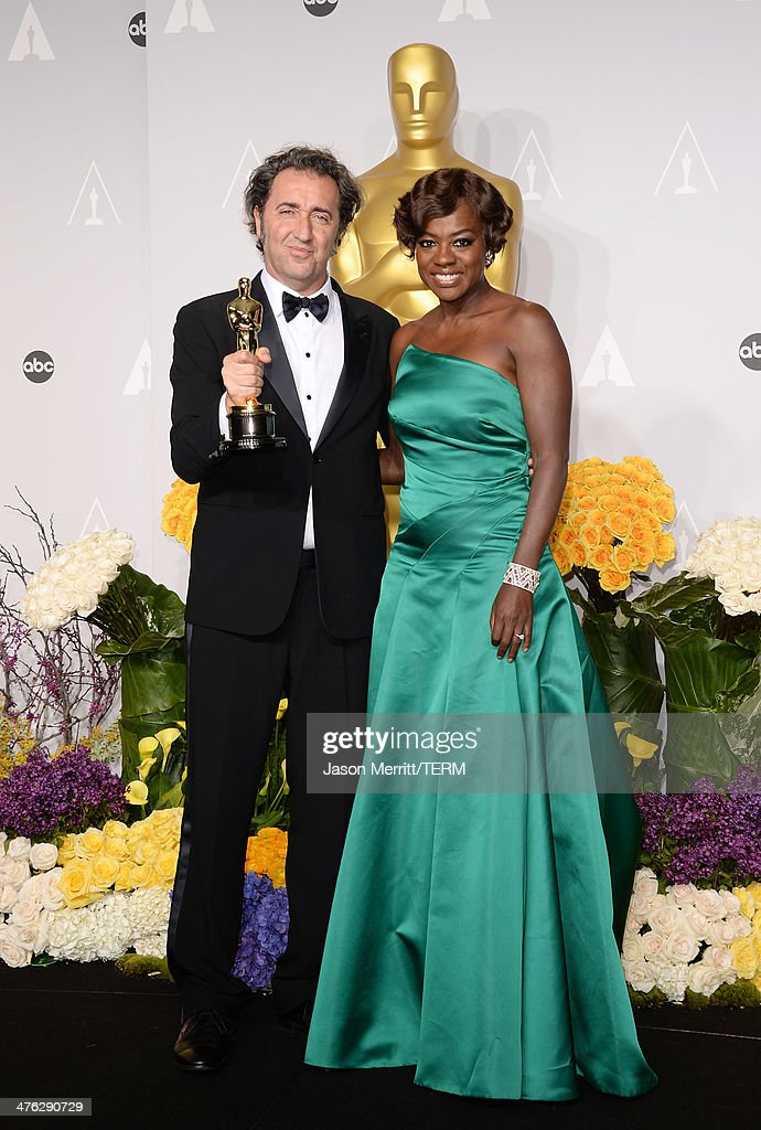 Director Paolo Sorrentino winner of Best Foreign Language Film of the Year and actress Viola Davis pose in the press room during the Oscars at Loews...