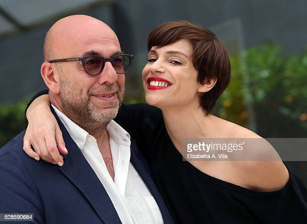 Director Paolo Virzi and actress Micaela Ramazzotti attend a photocall for 'La Pazza Gioia' at Visconti Palace Hotel on May 6 2016 in Rome Italy