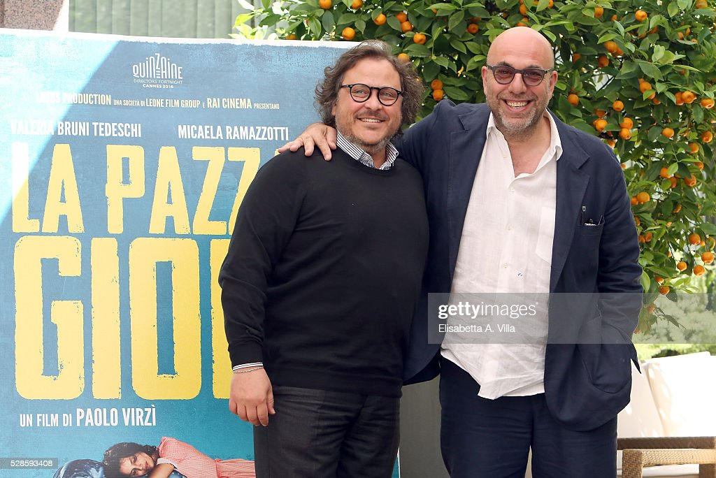 Director <a gi-track='captionPersonalityLinkClicked' href=/galleries/search?phrase=Paolo+Virzi&family=editorial&specificpeople=3021843 ng-click='$event.stopPropagation()'>Paolo Virzi</a> (R) and producer Marco Belardi attend a photocall for 'La Pazza Gioia' at Visconti Palace Hotel on May 6, 2016 in Rome, Italy.