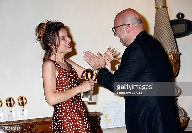 Director Paolo Virzi and wife Micaela Ramazzotti pose on stage with the Best Movie award for 'Il Capitale Umano' as they attend the Globi D'Oro...