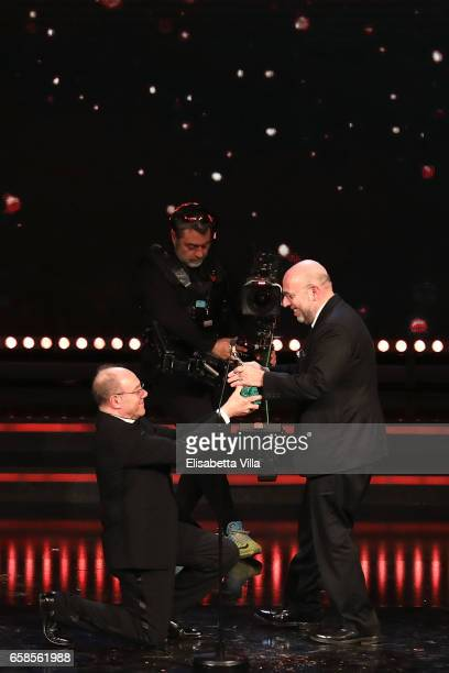 Director Paolo Virzi receives the Best Movie Award for 'La Pazza Gioia' from Carlo Verdone during the 61 David Di Donatello ceremony on March 27 2017...