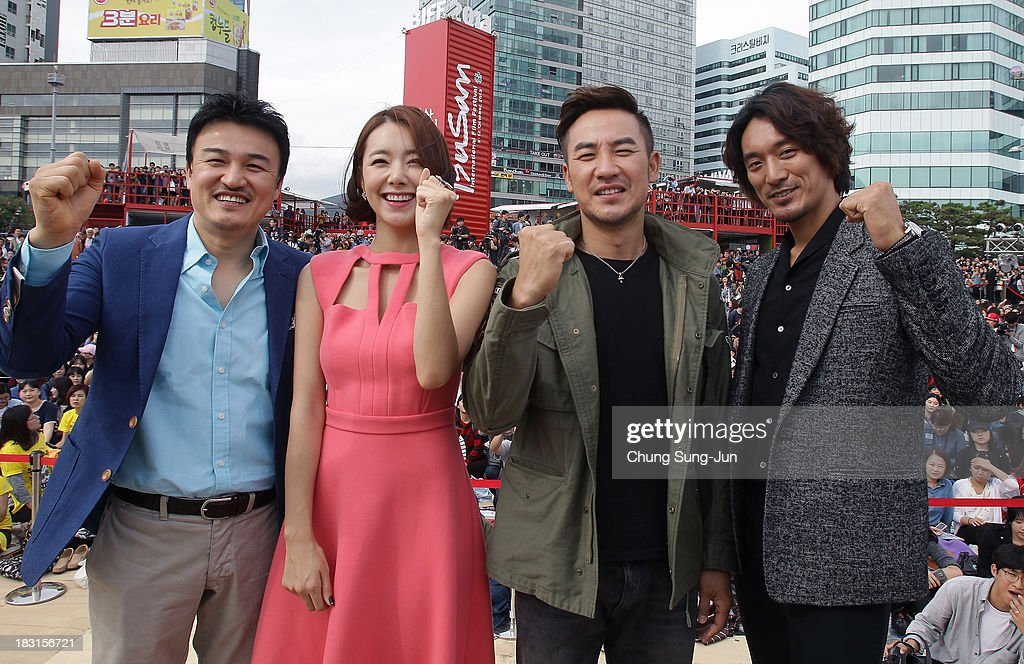Director Park JoongHoon actors So EHyun Uhm TaeWoong and Kim MinJoon attend the Open Talk at Haeundae beach during the 18th Busan International Film...