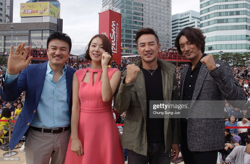 Director Park Joong-Hoon, actors So E-Hyun, Uhm Tae-Woong and Kim Min-Joon attend the Open Talk at Haeundae beach during the 18th Busan International Film Festival on October 5, 2013 in Busan, South Korea.