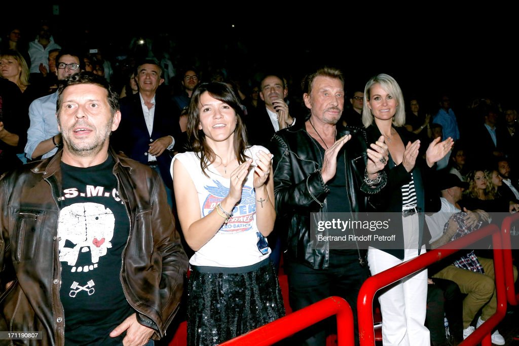 Director Pascal Duchene with companion Hortense d'Esteve, Singer Johnny Hallyday and his wife Laeticia Hallyday in the stand while Patrick Bruel performs at his last concert in Paris, held at Palais Omnisports de Bercy on June 22, 2013 in Paris, France.