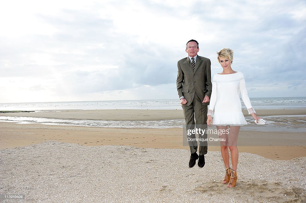 Director Patrice Leconte and Actress Pauline Lefevre pose as they attend the 25th Cabourg Film Festival on June 18 2011 in Cabourg France