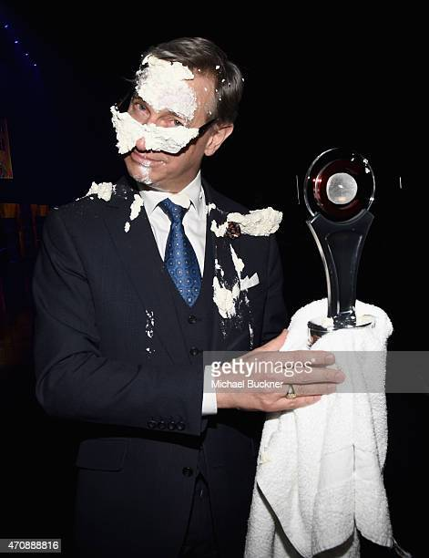Director Paul Feig poses with the Comedy Filmmaker of the Year Award backstage after being hit in the face with a pie at The CinemaCon Big Screen...