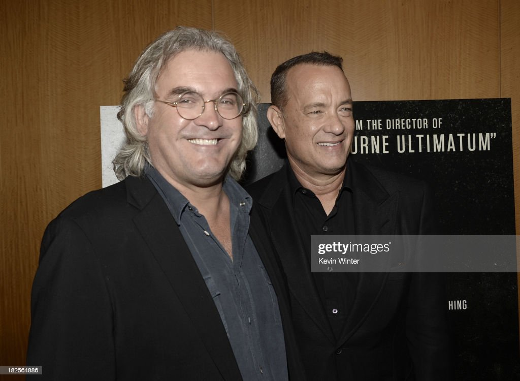 Director <a gi-track='captionPersonalityLinkClicked' href=/galleries/search?phrase=Paul+Greengrass&family=editorial&specificpeople=240256 ng-click='$event.stopPropagation()'>Paul Greengrass</a> (L) and actor <a gi-track='captionPersonalityLinkClicked' href=/galleries/search?phrase=Tom+Hanks&family=editorial&specificpeople=201790 ng-click='$event.stopPropagation()'>Tom Hanks</a> arrive at the premiere of Columbia Pictures' 'Captain Phillips' at the Academy of Motion Picture Arts and Sciences on September 30, 2013 in Beverly Hills, California.