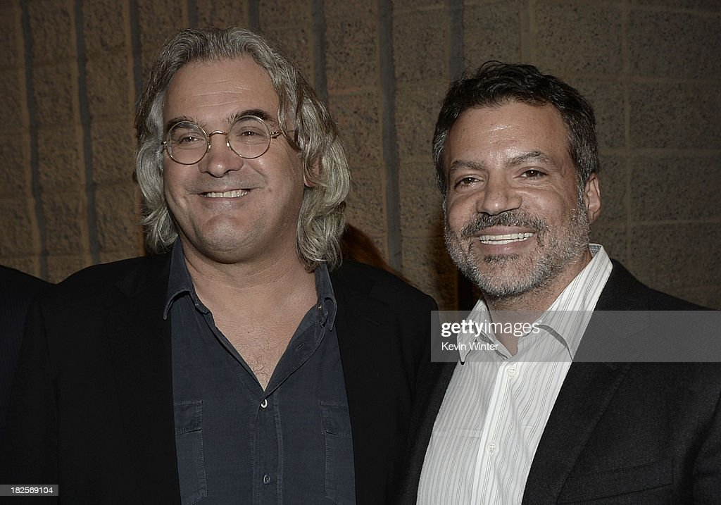 Director <a gi-track='captionPersonalityLinkClicked' href=/galleries/search?phrase=Paul+Greengrass&family=editorial&specificpeople=240256 ng-click='$event.stopPropagation()'>Paul Greengrass</a> (L) and producer <a gi-track='captionPersonalityLinkClicked' href=/galleries/search?phrase=Michael+De+Luca&family=editorial&specificpeople=2166393 ng-click='$event.stopPropagation()'>Michael De Luca</a> arrive at the premiere of Columbia Pictures' 'Captain Phillips' at the Academy of Motion Picture Arts and Sciences on September 30, 2013 in Beverly Hills, California.