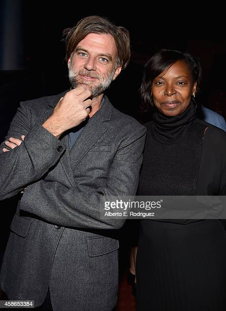 Director Paul Thomas Anderson and AFI Fest Director Jacqueline Lyanga attend the screening of 'Inherent Vice' during AFI FEST 2014 presented by Audi...