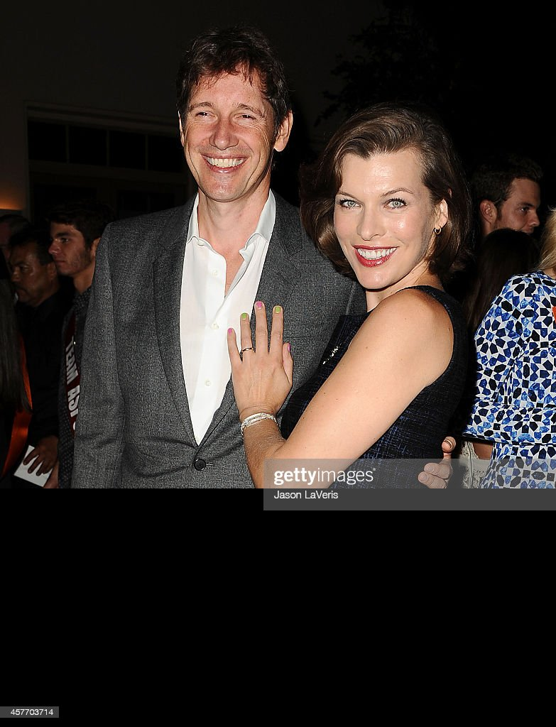 Director Paul W S Anderson and actress Milla Jovovich attend the ASPCA event on October 22 2014 in Bel Air California